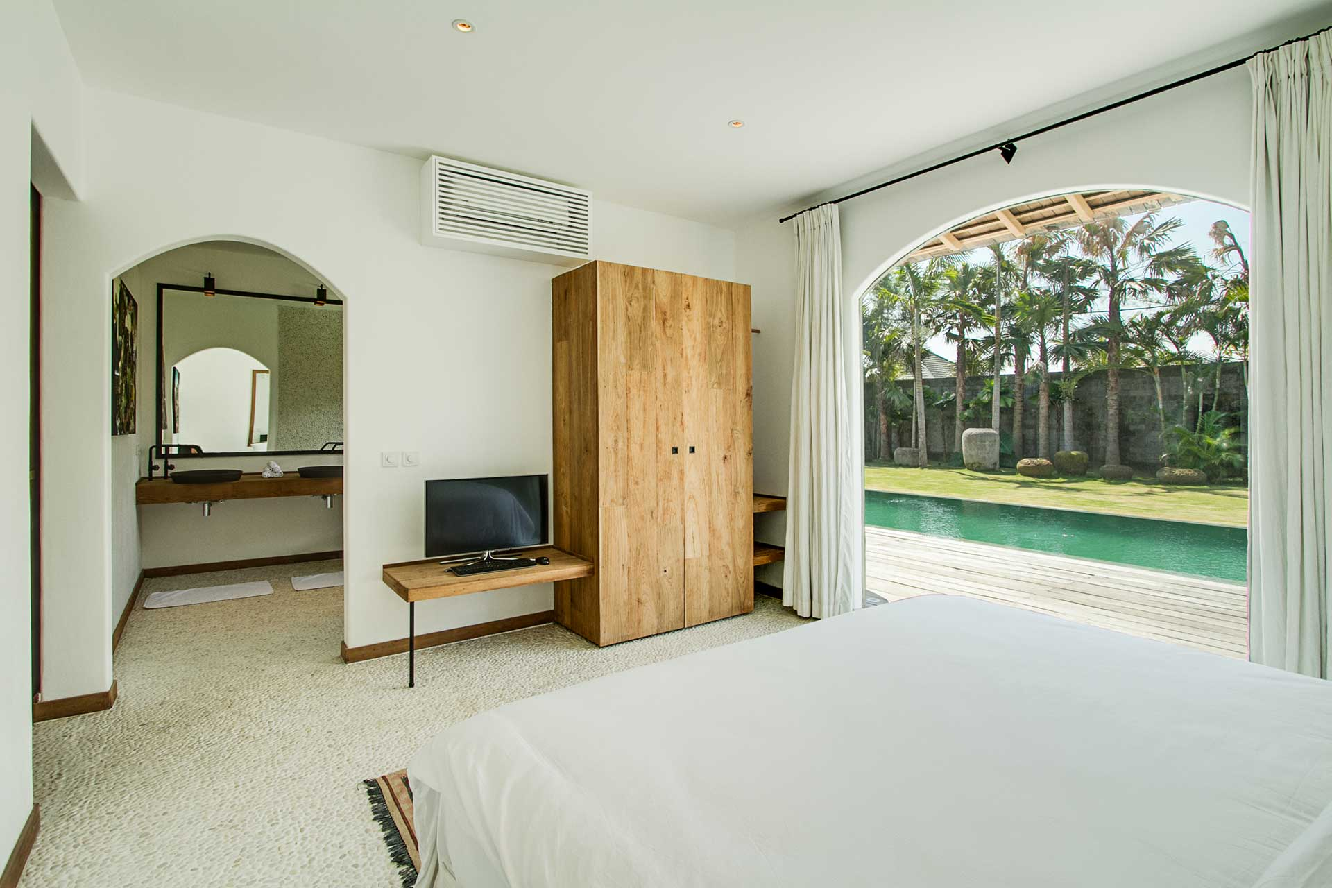 Main Villa Pool View Room, plenty of closet space and a private bathroom